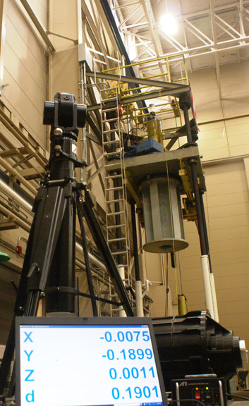 A laser system helps technicians align components of the tracker during initial assembly in Austin.