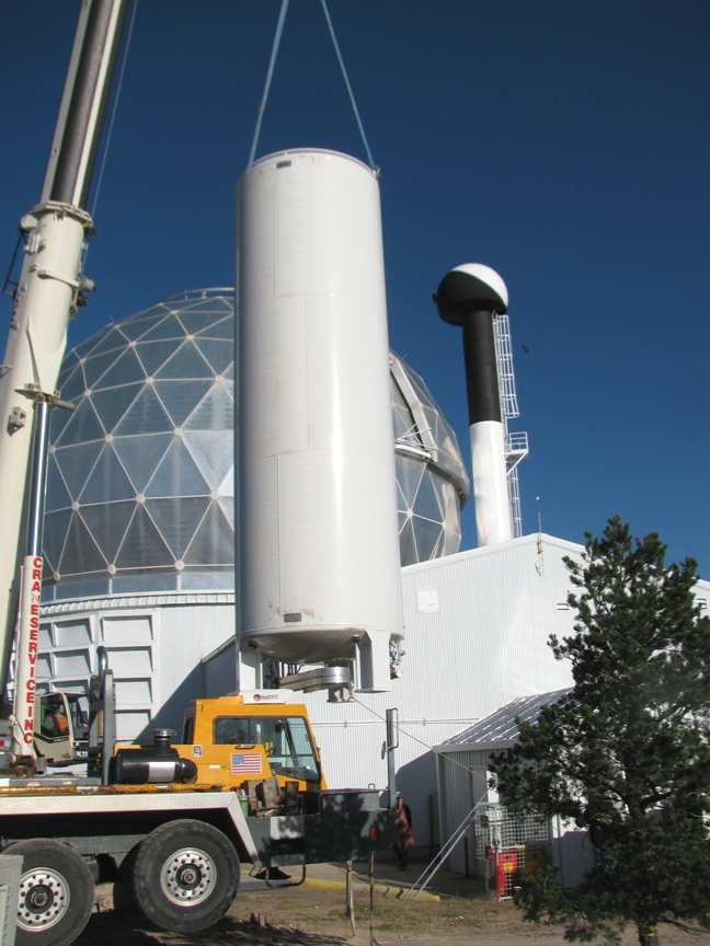 A crane lifts the liquid nitrogen tank for installation