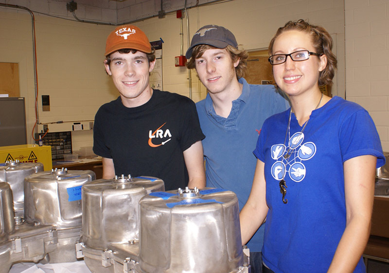 VIRUS assembly team members (L-R) Andrew Peterson, Trent Peterson, and Ingrid Johnson in a UT lab.